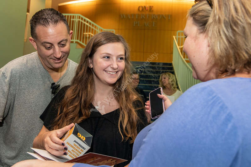 Acceptance letters are handed out as families arrive from campus tours at the Visitor Center September 13th, 2019.  (WVU Photo/Brian Persinger)