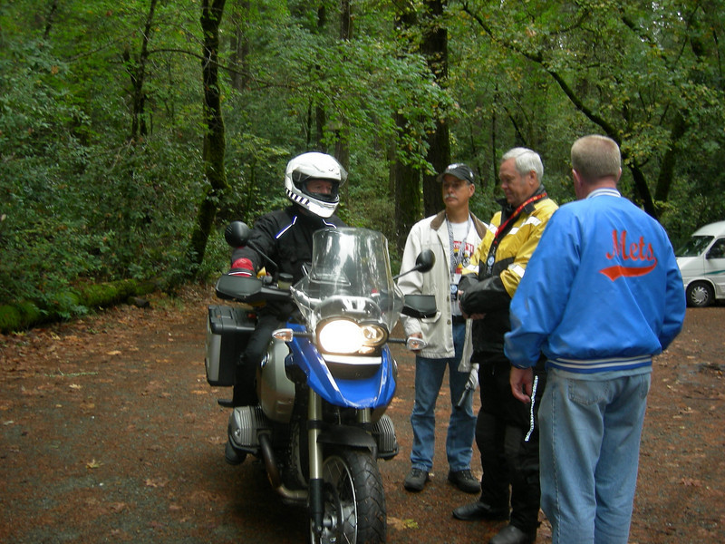 """Mike Morlin arrives on his """"new"""" R1200GS. Scot Marburger, Russ Drake & Peter Oxenbol admire the new technology."""