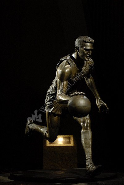 Jerry West Statue at night