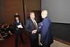 President Garrison presenting award to ROTC Cpt. Golart