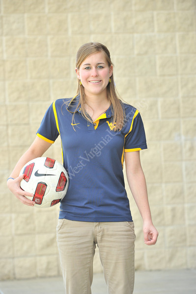 WVU Experience student Tiphani Guldner poses for photos at the WVU Evansdale sports facility , April 2011. (WVU Photo/Greg Ellis)