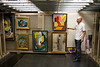 Robert Bridges, curator of the Art Museum of WVU, pulls out a storage rack displaying pictures by West Virginia painter Blanche Lazzell in the art storage area in the downtown library.