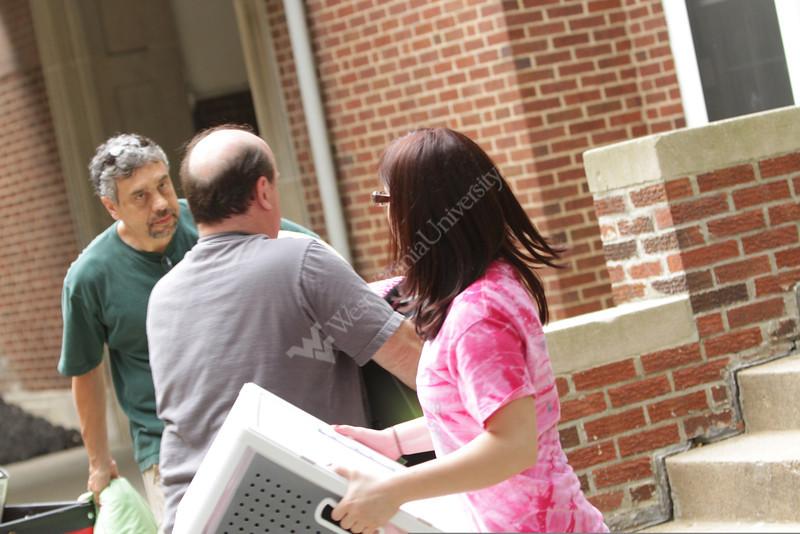 WVU freshmen students move into their dorm rooms at WVU Boreman Hall downtown campus, August 2011. (WVU Photo/Mark Brown)