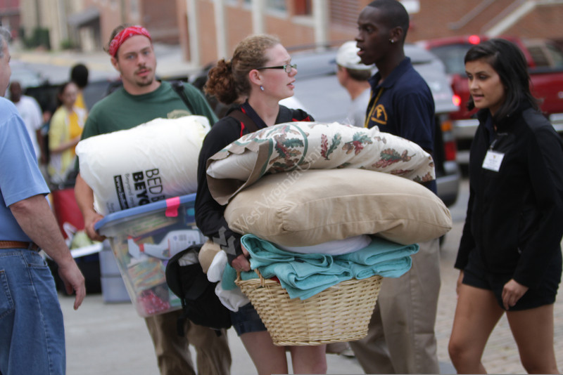 WVU freshmen students move into their dorm rooms at WVU Boreman Hall downtown campus, August 2011. (WVU Photo/Mark Brown)