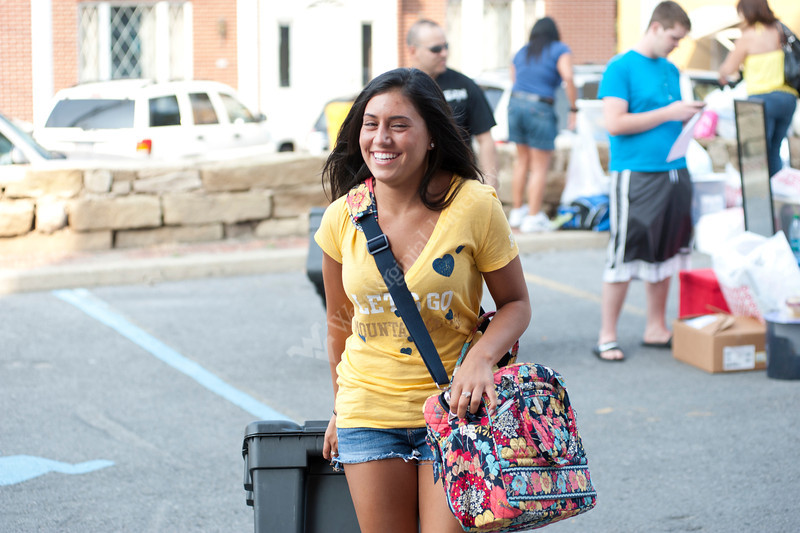 WVU students move into their dorm rooms at Summit hall WVU evansdale campus with the aid of housing staff their parent, friends and student volunteers, August 2011.