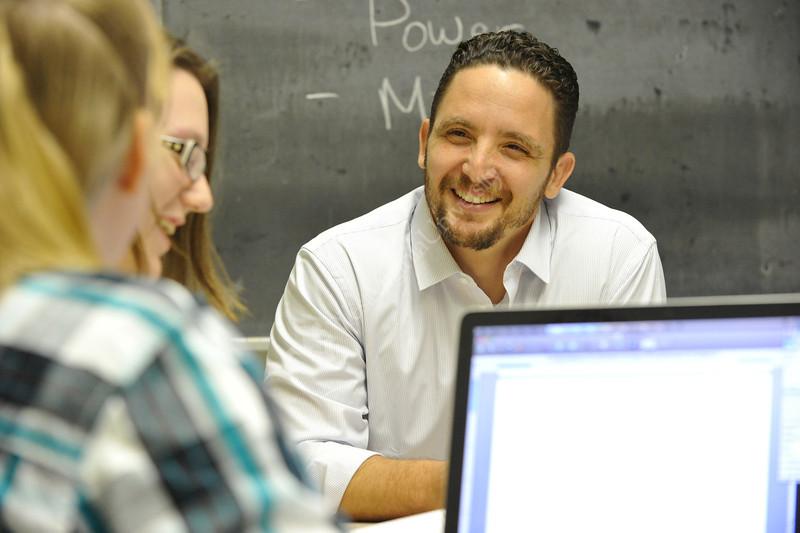 WVU high school teachers work with WVU Eblery college faculty to develop and refine  their teaching skills WVU downtown campus, August 2011. (WVU Photo/Greg Ellis)