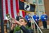 Grant Rumble of the WVU Marching Band plays taps at the 2011 Peal Harbor Day ceremony at Oglebay Hall plaza.