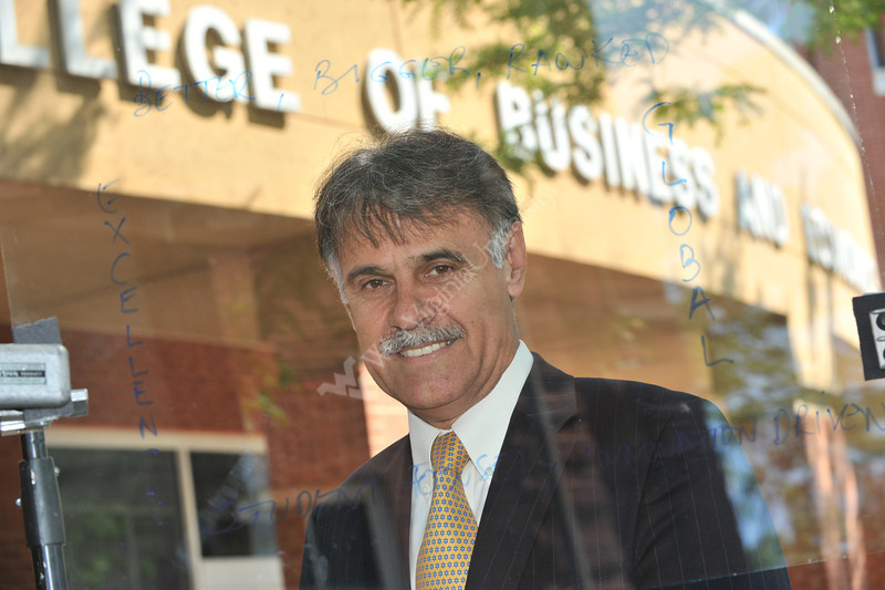 WVU College of Business and Economics Dean Zito Sartarelli poses for photos outside of the WVU College of Business and Economics downtown campus, July 2011. (WVU Photo/Greg Ellis)