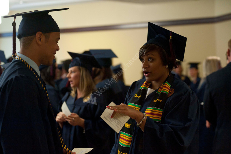 WVU School Of Journalism graduates take part in their commencement at the Waterfront Hotel, May 2011. (WVU Photo Todd Latocha)