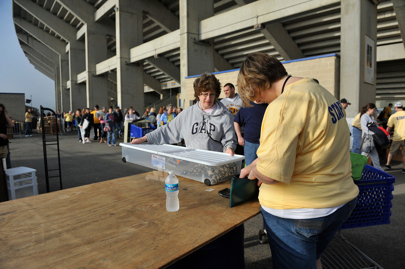 WVU fans take part in the United Way Blue and Gold mine sale at Puskar Stadium, May 2011. (WVU Photo/Todd Latocha)