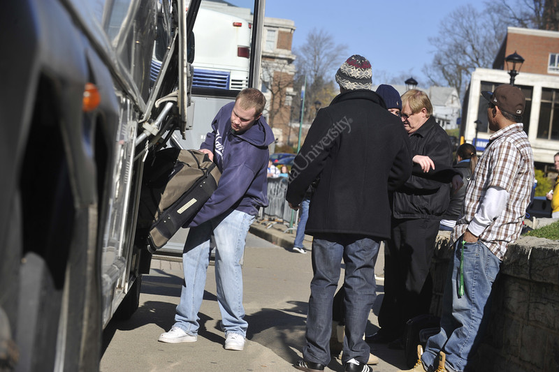 WVU provides bus transportation leaving from the Mountainlair downtown campus to transit hubs for WVU students returning home for the Thanksgiving break,  November 2011. (WVU Photo/Brian Persinger)