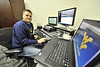 WVU Football video producer Brett Kelly poses for photos in his office Puskar stadium evansdale campus, October 2011. (WVU Photo/Greg Ellis)