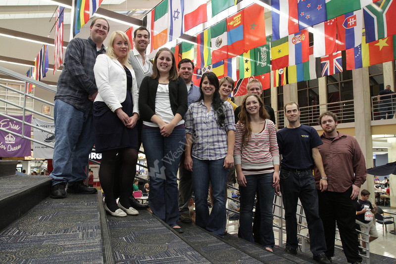 WVU Eblery Collage students pose for photos with flags WVU Mountainlair downtown campus, September 2011. (WVU Photo)