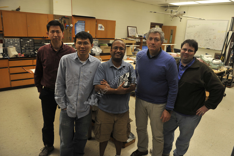 WVU Professor Marcello Napolitano and his MAE team pose for photos in their lab, April 2012. (WVU Photo/Greg Ellis)
