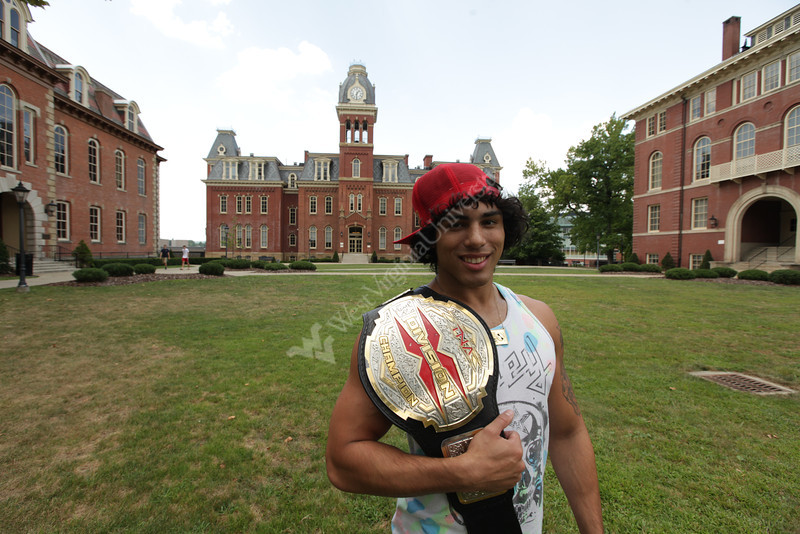 WVU senior Michael Paris is a professional wrestler. He competes in the TNA under the name Zema Ion. He has one more class to finish to get his degree from the J-School. On this day he studied on campus, had lunch with his sister and girlfriend and wrestled in an IWC match at Court Time Sports Center in Elizabeth, Pennsylvania.