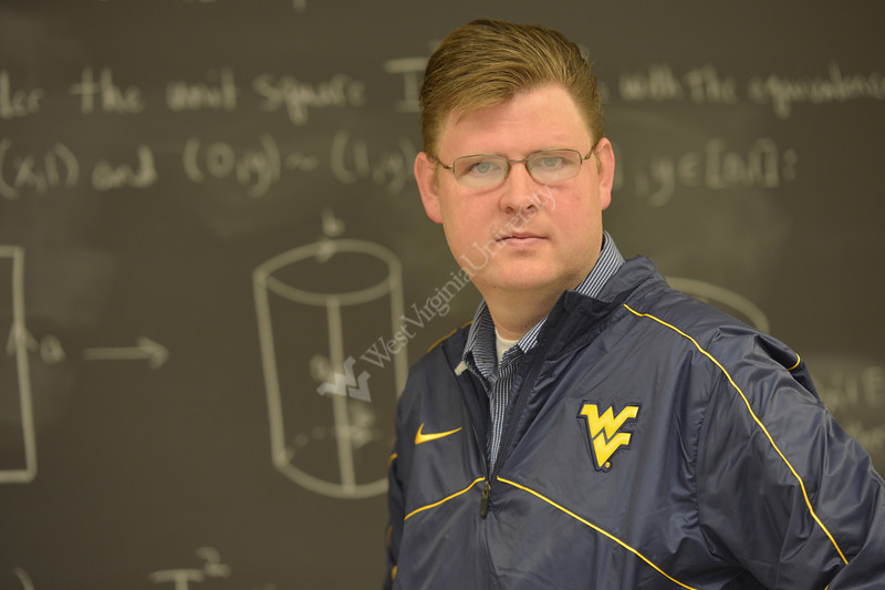 WVU Physics Professor David Miller  poses for an Environmental Portrait December 2012 (WVU Photo/Greg Ellis)