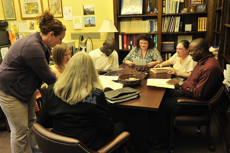 WVU undergraduate students interact with the  WVU Undergraduate Advising Center staff receiving academic guidance, April 2012 (WVU Photo/Greg Ellis)