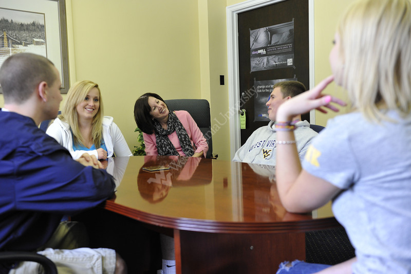 WVU Well Student Services staff pose for photos with WVU students at their facilities on the WVU campus, March 2012. (WVU Photo/Greg Ellis)