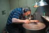 Ellie Mannette tunes and works on Steel Drum at his Westover WV facility May 2012 (WVU Photo/Jake Lambuth)