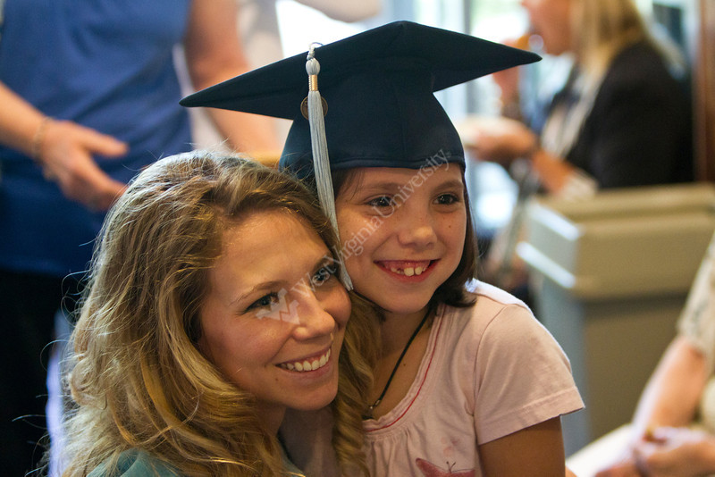 Megan Hoff poses for a picture with her young cousin Sophia Kimble after graduating at the 2012 Honors Convocation.
