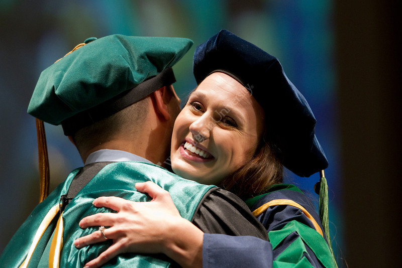 Heather Flesher hugs her brother in law after receiving her diploma at the WVU School of Medicine's 2012 Commencement Ceremony.