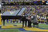 James Miltenberger CAC professor  of music play his  Steinway Piano  at the WVU, TCU halftime November 2012 (WVU Photo/Brian Persinger)