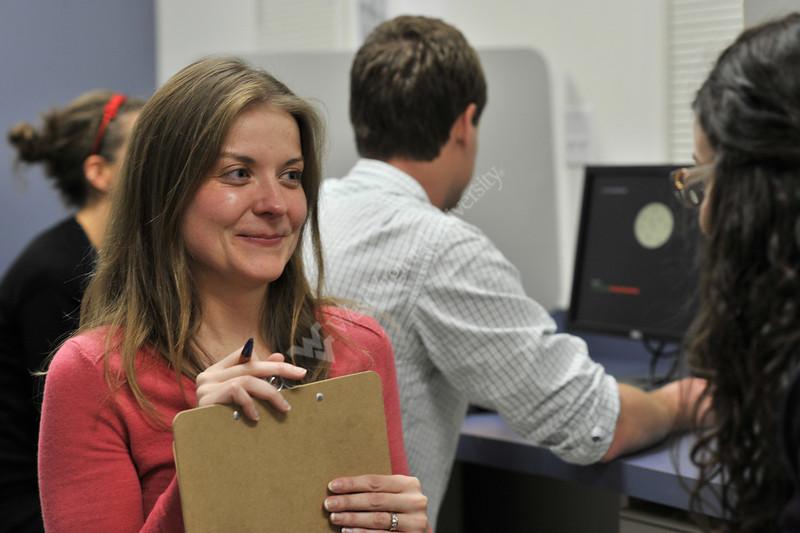 28639 Dr. Natalie Shook works in her lab with students WVU life Science November 2012 (WVU Photo/Greg Ellis)