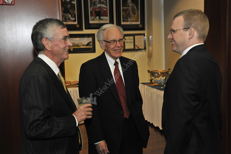 Robert Maust  WVU College of B&E greets guests at his Retirement Reception October 2012 (WVU Photo/Greg Ellis)