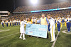 The Pride of West Virginia receives check at halftime of the WVU vs. Kansas State football game October 20, 2012. Photo by Allison Toffle