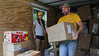 WVU students Savannah Lusk and Trevor Kiess traveled to Clay County to deliver supplies to people affected by flooding.  Photo by Scott Lituchy / West Virginia University
