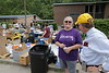 WVU President Gordon Gee talks with Anita Stephenson, principal at Clay County Middle School. Gee traveled with a group of students to Clay County to deliver supplies to people affected by flooding.  Photo by Scott Lituchy / West Virginia University