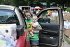 Christy Nottingham and her son Desmond Moore, 6 months, stopped by Clay County High School to pick up supplies. WVU students traveled to Clay County to deliver supplies to people affected by flooding.  Photo by Scott Lituchy / West Virginia University