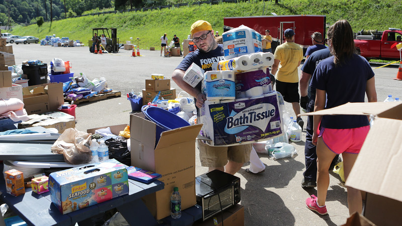 Andrew Facemire, of WVU's Center for Service and Learning, and WVU students traveled to Clay County to deliver supplies to people affected by flooding.  Photo by Scott Lituchy / West Virginia University