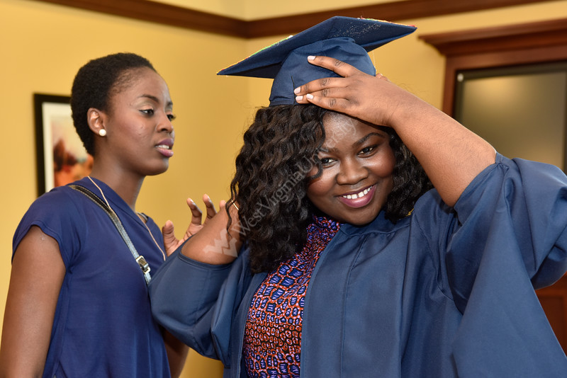 A Public Health graduate is all smiles as she prepares for commencement Friday, May 13, 2016.