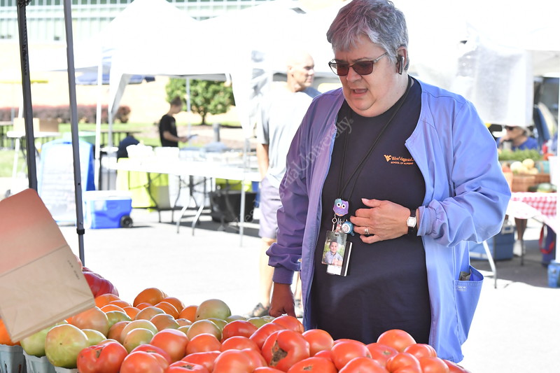 Students, staff and local residents enjoy the offerings of the WVU Medicine farmers market on WVU Heath Scenes campus July 26, 2017. Photo Greg Ellis