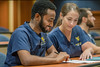 WVU Dentistry students collaborate in the classroom August 2017. Photo Greg Ellis