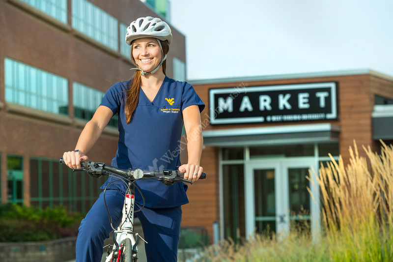 Megan Walker 4th year dental student is seen with her bike and fellow 4th year dental student Elyse Reihner on the  HSC campus August 28, 2017. Photo Greg Ellis