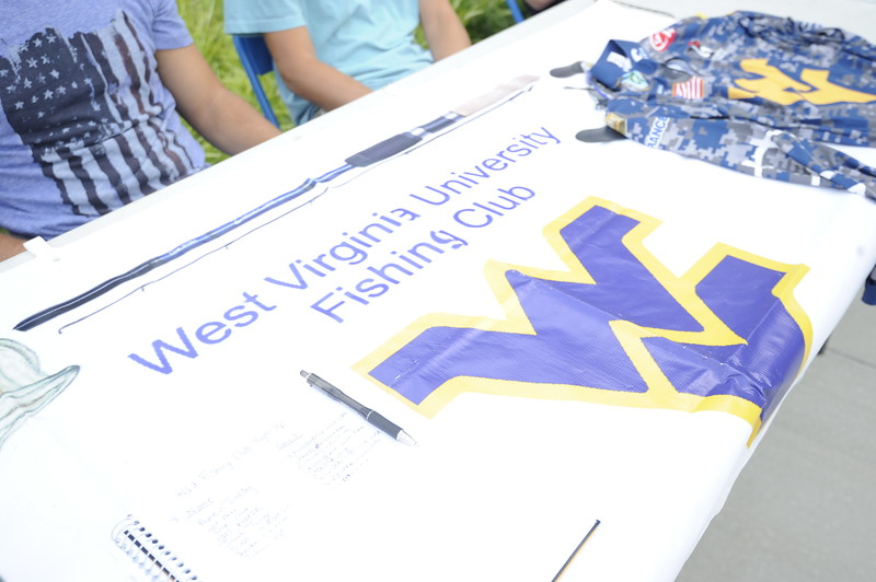 Students, alumni and faculty come together behind the Agricultural Sciences Building on the Evansdale Campus to celebrate the Davis College's and the university's 150th anniversity with a barbecue August 31, 2017. The college also came together to celebrate the naming of the two new tomatoes species created at WVU: West Virginia '17A (Mountaineer Delight) and West Vriginia '17B (Mountaineer Pride.)