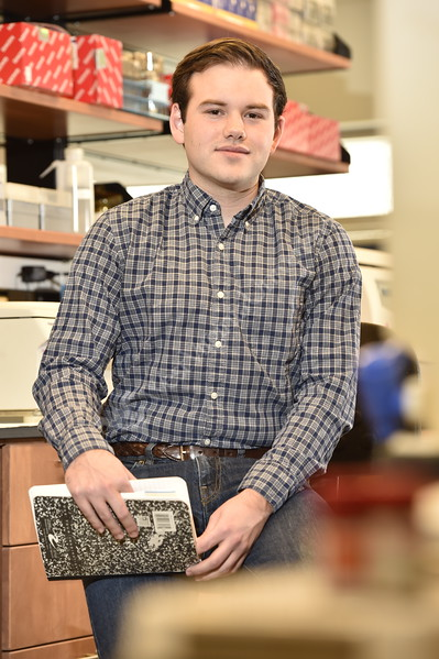 Patrick Thomas, a biochemistry major poses for an environmental portrait in his lab within the  Erma Byrd Biomedical Research Center December 7, 2017. Photo Greg Ellis