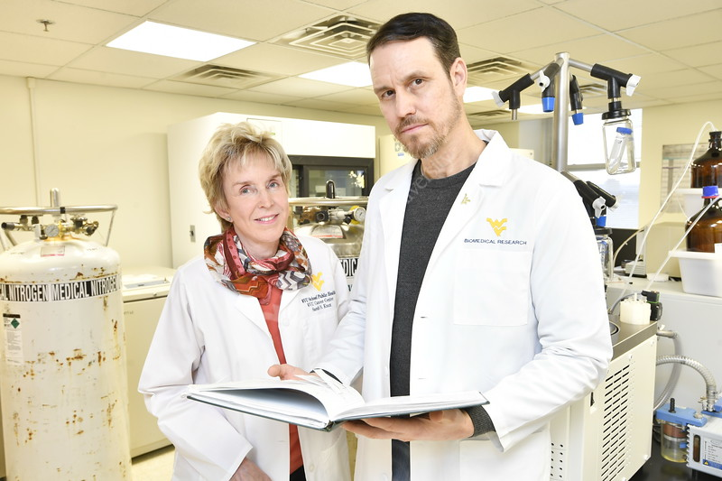 Sarah Knox and Tim Eubank Tumor Immunologist pose for a picture in their lab at WVU HSC December 7, 2017. Photo Greg Ellis