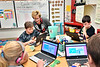 Students in Mrs. Mattern's third grade class room (L to R)  Samantha Laudermilch, Damon Patchen, Gale Manchin West Virginia's Secretary of Education and the Arts,  and Chade Staggs participate in a day of CODE at Mylan Park Elementary School Morgantown WV December 8, 2017. Photo Greg Ellis