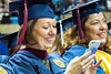Kathryn Jones  Reed College graduate shares her excitement with friends via social media at the WVU commencement December 15, 2015. Photo Greg Ellis