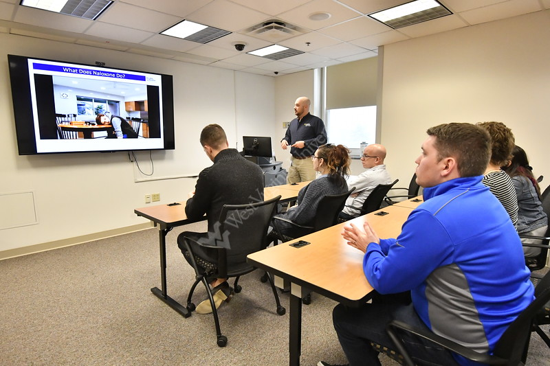WVU staff participate in Naloxone training at the WVU STEPS Lab December, 18,2017. Photo Greg Ellis
