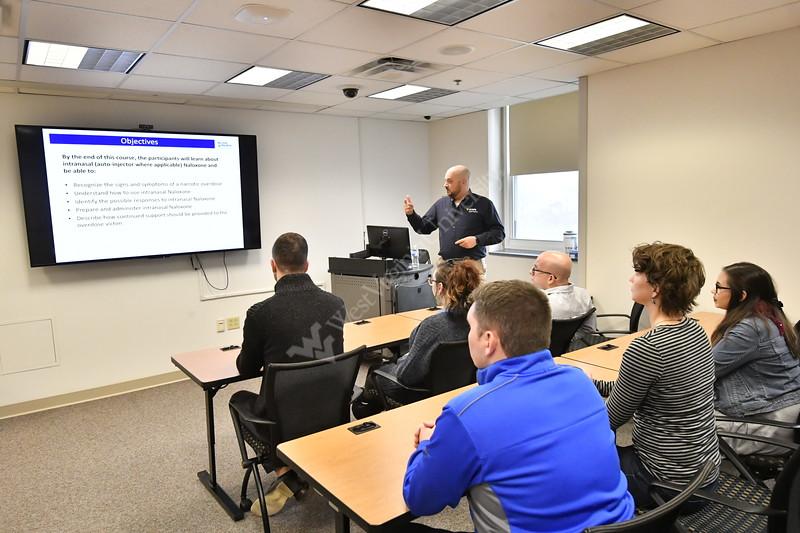WVU staff participate in Naloxone training at the WVU STEPS Lab December, 18,2017. Photo Greg Ellis