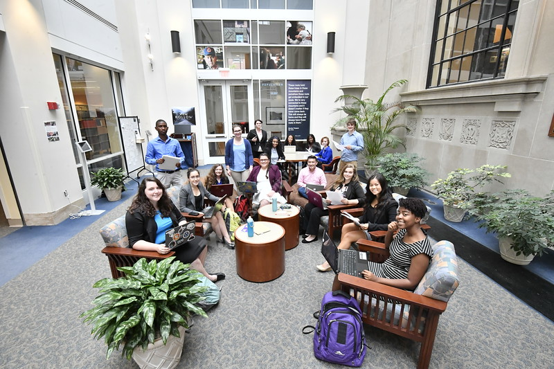 WVU's 16 McNair Scholars pose for a group shot in the Wise Library 2nd floor atrium located on the downtown WVU campus, June 16, 2017. Photo Greg Ellis