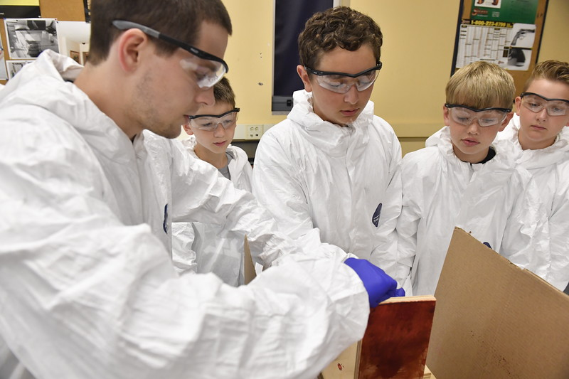 Students participate in the Foirensic Summer Camp offered at the Crime Scene House complex on the Evansdale Campus June 22nd, 2017.  Photo Brian Persinger