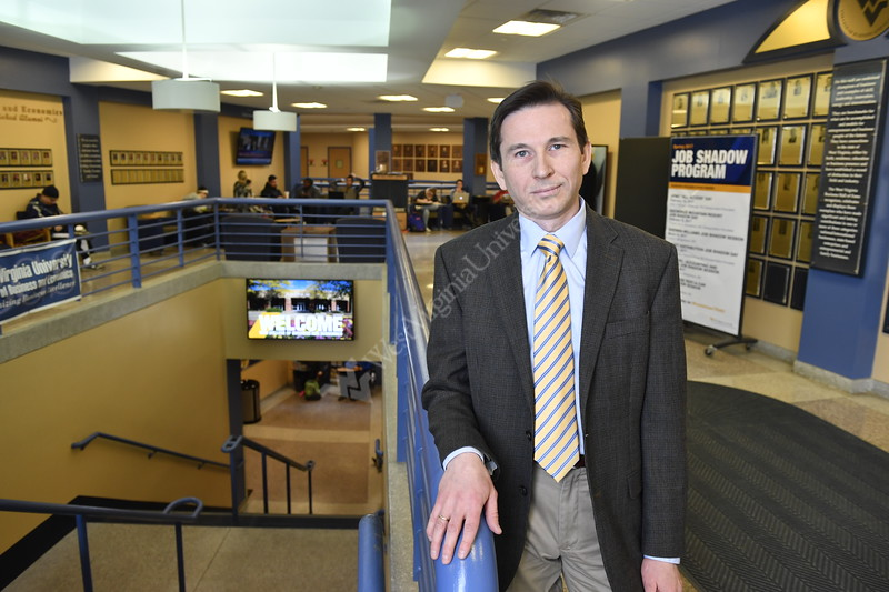 Associate Professor of Economics and Finance Dr. Alex Kurov poses inside the 4th floor of the Business and Economics Building March 20th, 2017. Photo Brian Persinger