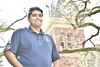 Roshan Daniel, is seen on the WVU downtown campus with an historic building in the  background, March 21, 2017.