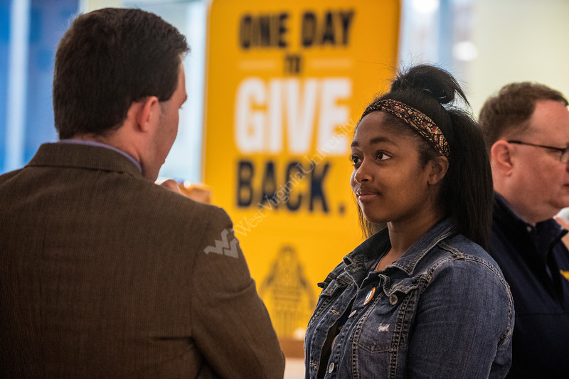 """Hannah Davis a Music Education major talks with university members as WVU holds its, """"Day of Giving"""" campaign in the Mountainlair November 8th, 2017.  Photo Brian Persinger"""