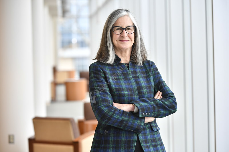 Ann Chester Asst VP for Education Partnerships, Director of HSTA, Director of HCOP, Deputy Director of the Center of Excellence in Women's Health posers for an Environmental Portrait in the HSC library November 9. 2017. Photo Greg Ellis